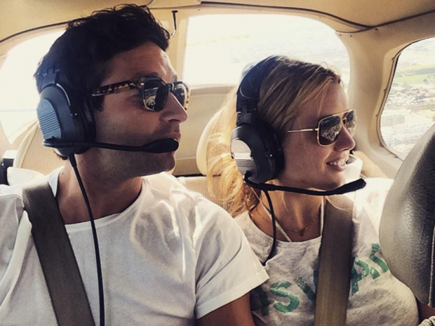Caggie Dunlop and Scott Sullivan take a helicopter ride in Instagram photo