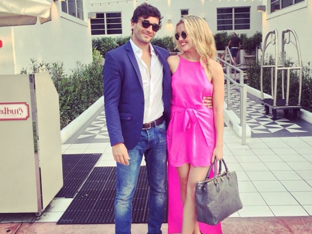 Caggie Dunlop and Scott Sullivan at the Versace Mansion in Instagram photo