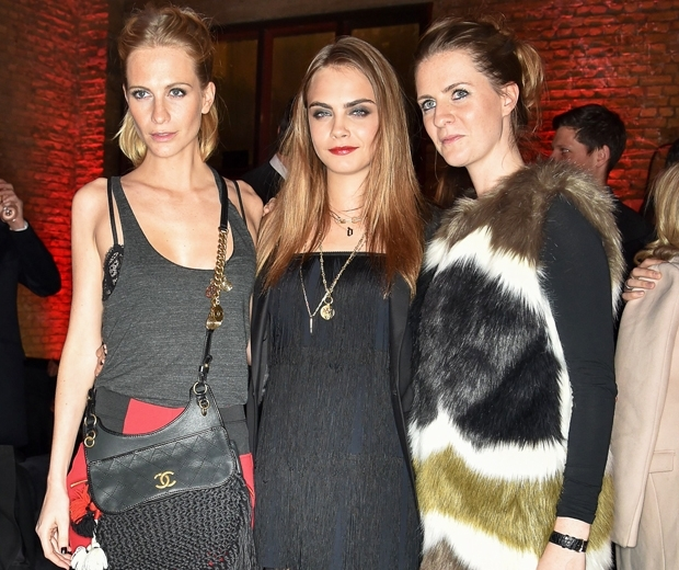 Cara Delevingne with her sisters Poppy and pregnant Chloe