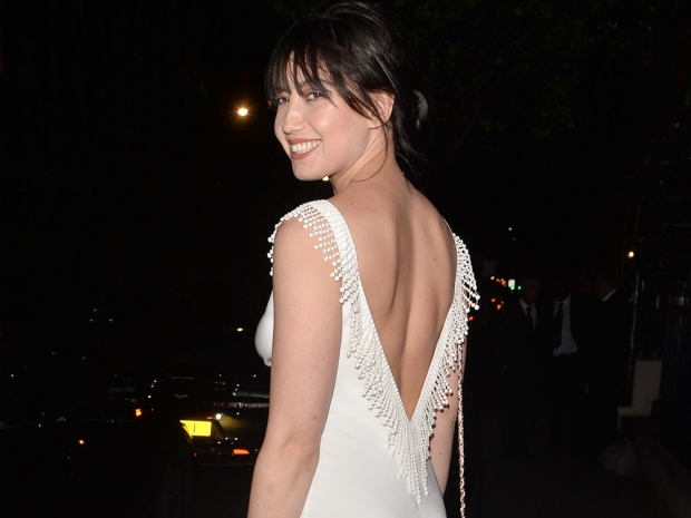 Daisy Lowe showing the back of her Halfpenny London dress at the Blossom Ball