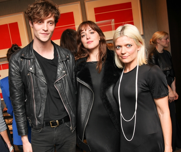 Dakota Johnson and Matthew Hitt in black at fashion party