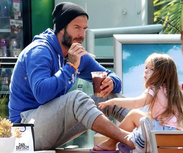 Harper Beckham rocking denim shorts, flip flops and a pink t-shirt