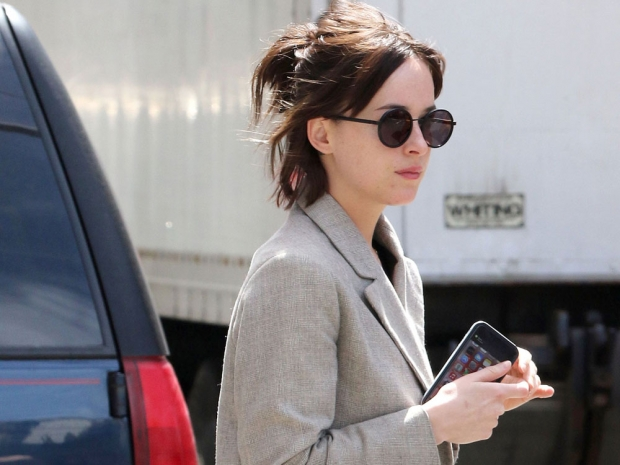Dakota Johnson pulls her new hair back into a no-fuss updo