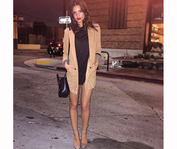Emily Ratajkowski  in a black dress and a coat on instagram