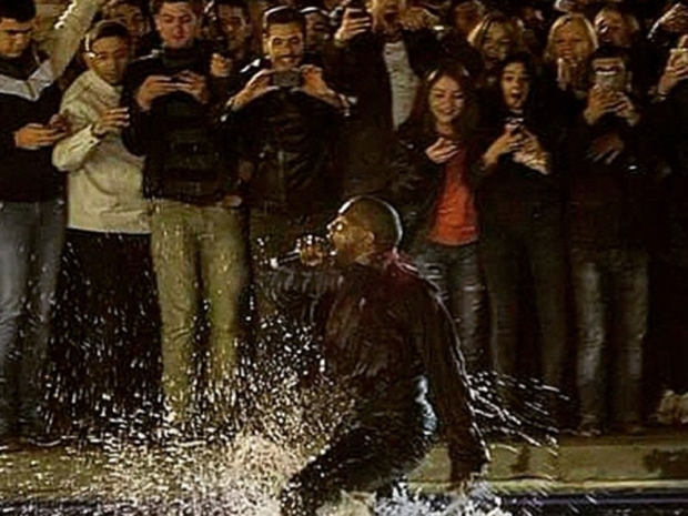 The rapper jumped into the lake as part of his performance