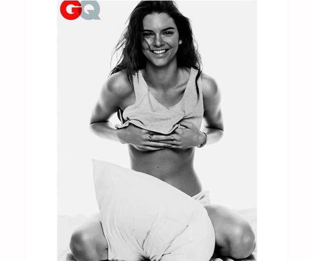 Kendall Jenner posing in a grey crop top inside the May issue of GQ