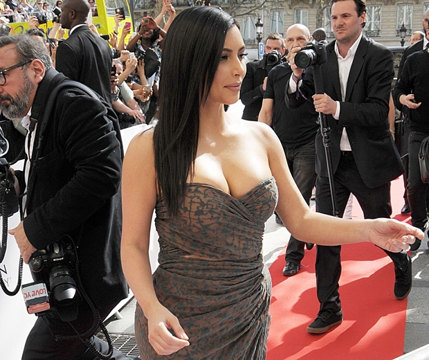 kim kardashian greeting fans at the Marionnaud Champs Elysees in Paris