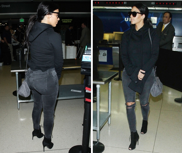 Kim Kardashian worked a hoodie and jeans at LAX the day before