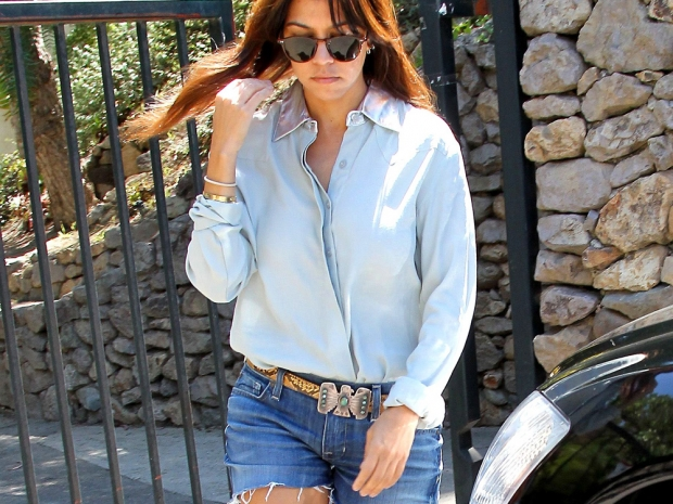 Kourtney Kardashian wearing a denim shirt on a day out in Los Angeles
