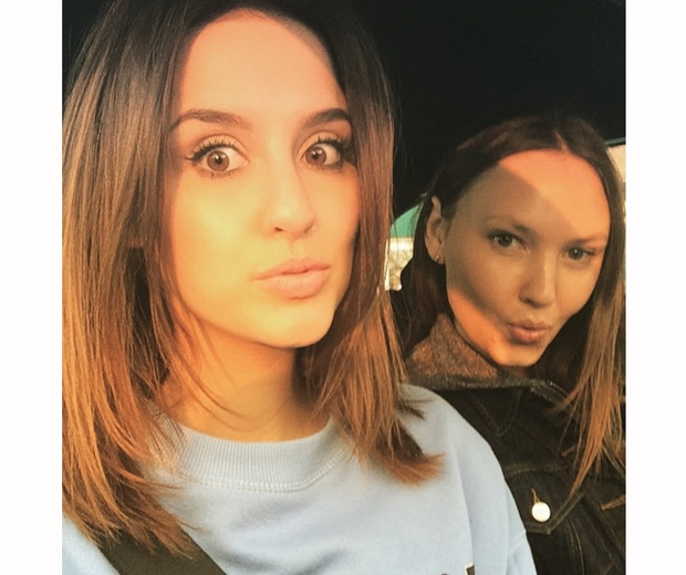 MAde in chelsea's lucy watson filming in blue jumper with short hair