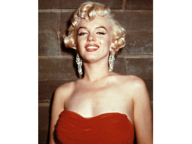 Marilyn Monroe in a red dress and diamond earrings
