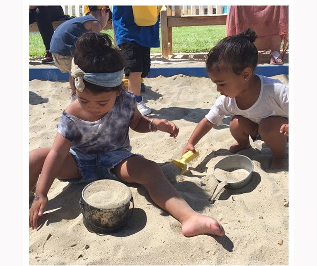 north west playing in sandpit