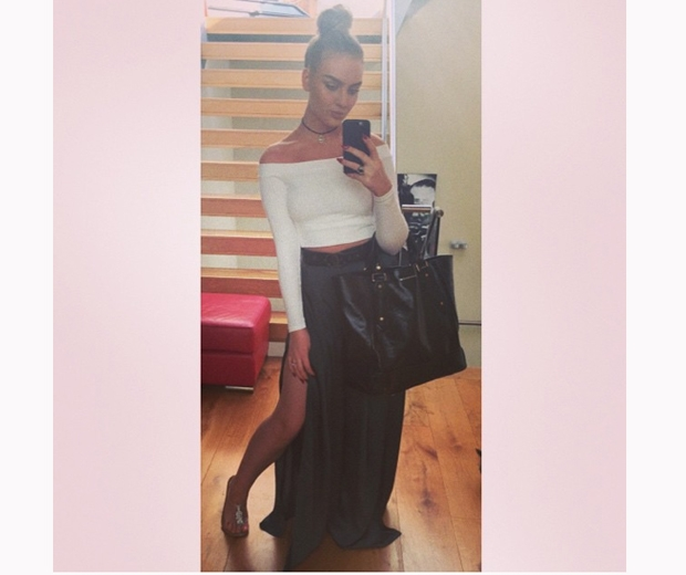 Little Mix's Perrie Edwards working a side-split skirt and a crop top on Instagr