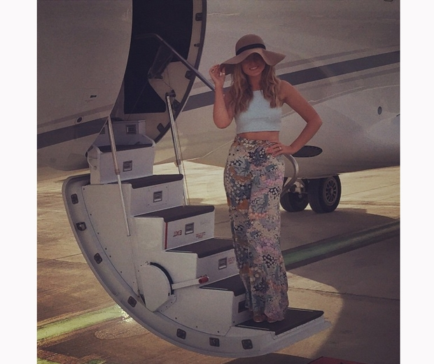 perrie edwards in patterned wide leg trousers on holiday with zayn malik