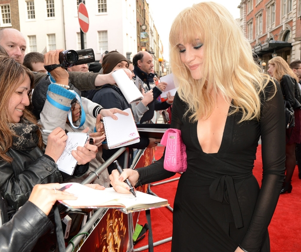 Pixie Lott parading her new hair on the red carpet at the Olivier Awards