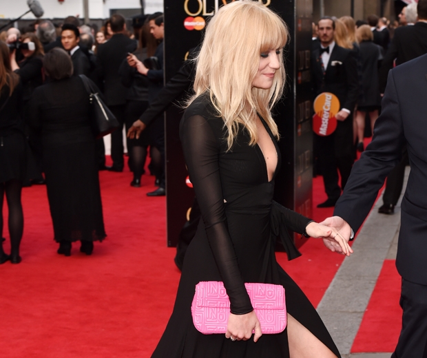 Pixie Lott worked a sexy thigh-split dress and a hot pink clutch