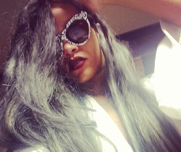 Rihanna working her icy grey hair back in July 2013