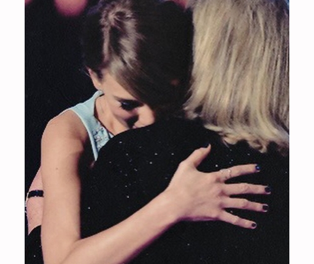 Taylor Swift and mum Andrea share an emotional hug on stage at the ACM Awards