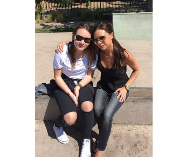 Victoria Beckham wearing jeans a black camisole with niece Libby over East