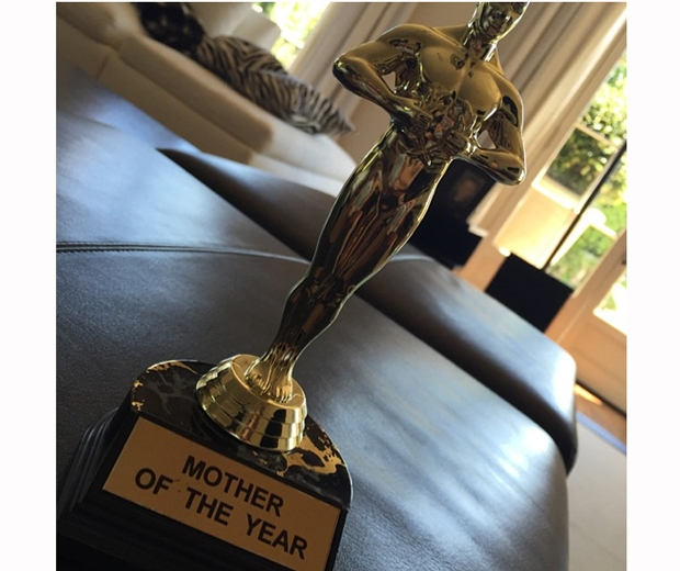 Victoria Beckham wins a 'Mother Of The Year' trophy on her birthday. Aw!