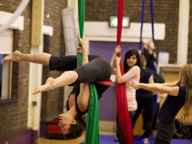 Participants get tied up at Aerial Silks