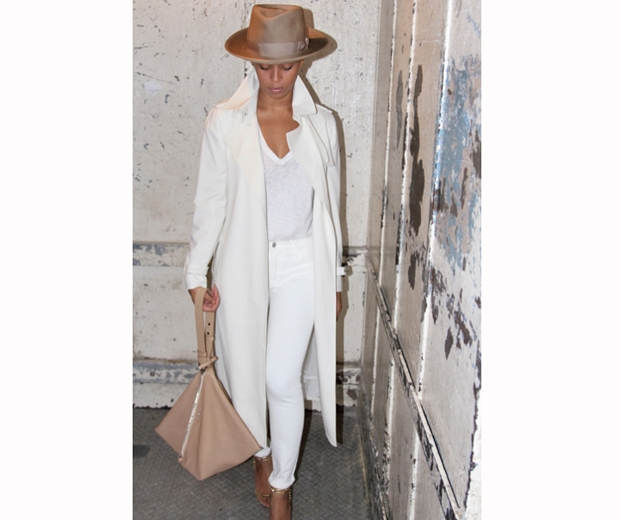 beyonce in white coat, brown hat and with a long plait