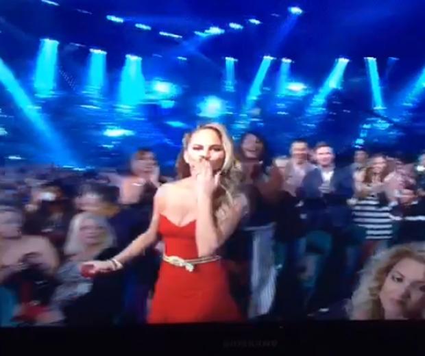 chrissy teigen in red dress at billboard music awards