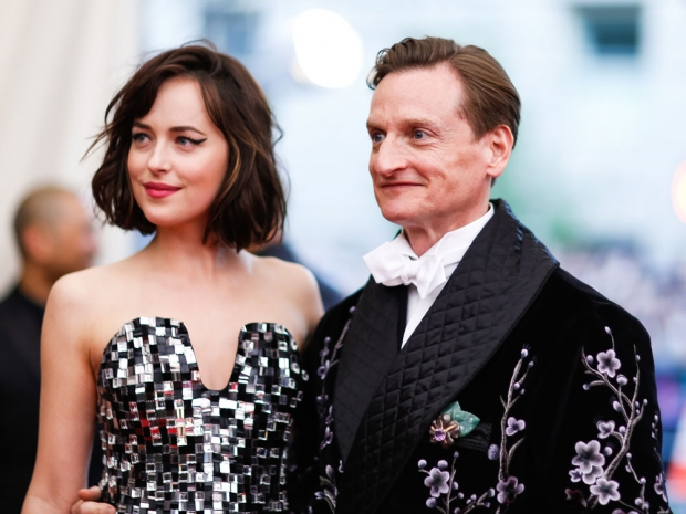 Dakota shines next to Hamish Bowles, Editor-At-Large for American Vogue