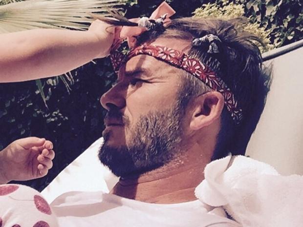 David Beckham gets his hair done by daughter Harper Beckham in Instagram photo