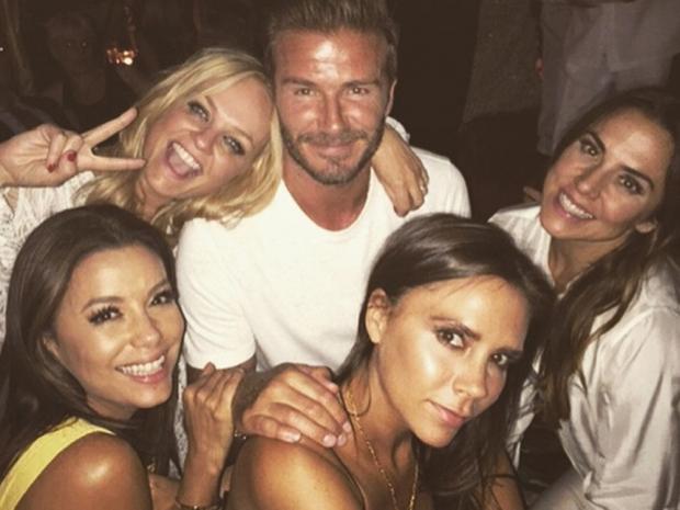 David Beckham poses with Emma Bunton, Mel C, Victoria Beckham and Eva Longoria