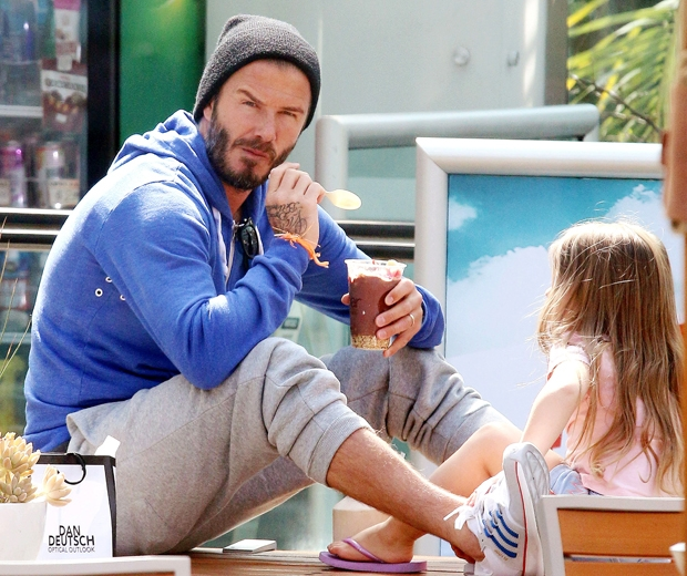 David Beckham looked relaxed in grey joggers and a blue hooded sweater