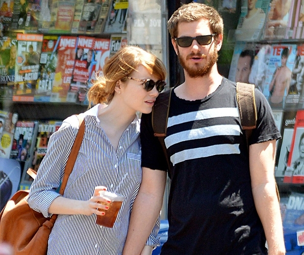 emma stone and andrew garfield walking along street in casual clothes