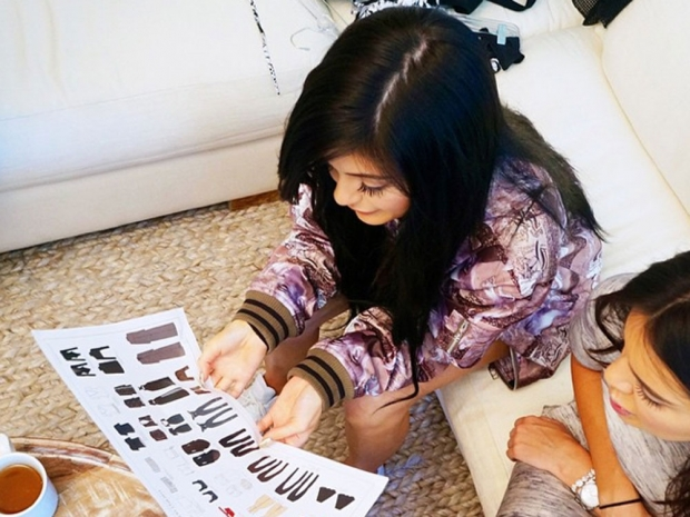 Kendall Jenner and Kylie Jenner looking at designs in Instagram photo