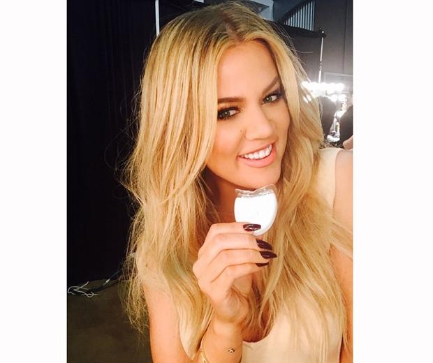 Khloe Kardashian blonde hair teeth whitening product