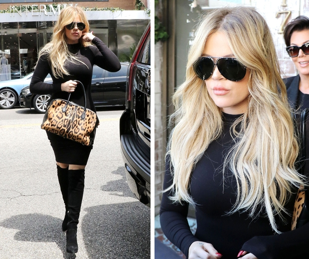 Khloe Kardashian and her new blonde hair looked glam in a fitted black dress