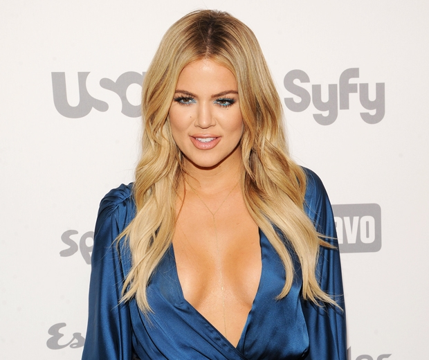 khloe kardashian in blue silk plunging dress