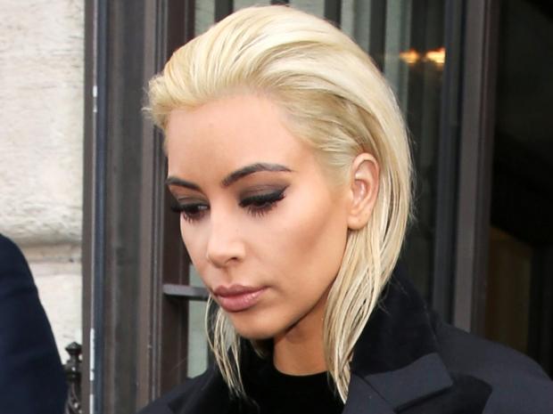 Kim Kardashian debuting her platinum look at Paris Fashion Week
