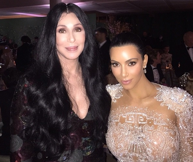 kim kardashian takes a photo with cher at the met gala