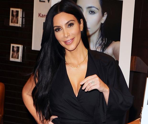 kim kardashian in black dress at la selfish book launch