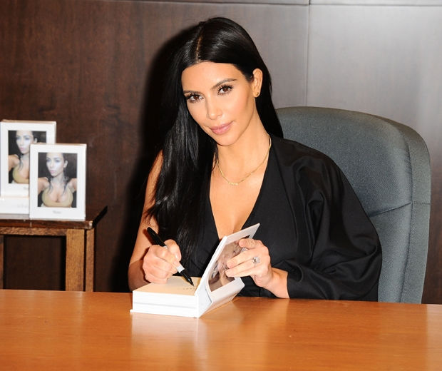 Kim Kardashian signing her Selfish book for fans at her launch in LA