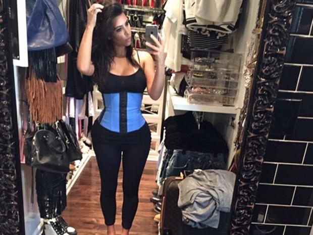 Kim Kardashian using a waist trainer in Instagram photo