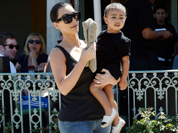 Kim Kardashian with daughter North in a black outfit