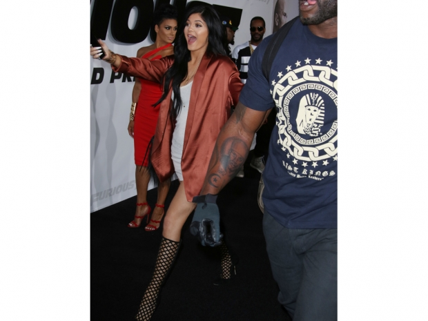 Kylie Jenner wearing thigh-thigh boots at the Fast And Furious 7 premiere in LA