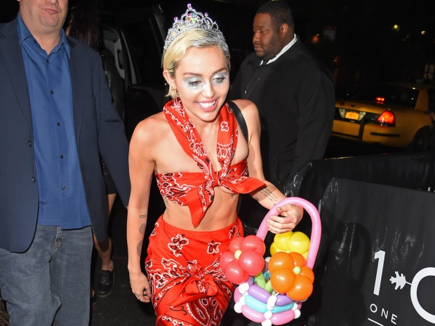 Miley Cyrus wearing a coral combo out in New York