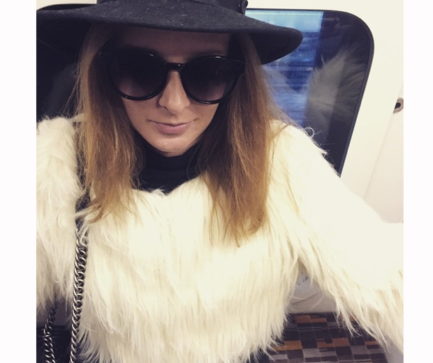 millie mackintosh on tube in white fur coat and black hat