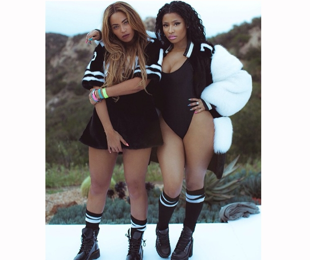 Beyonce and Nicki Minaj in sports jerseys in their new Feelin' Myself video