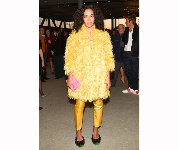 solange knowles in yellow feathers at Max Mara party of The Whitney Museum