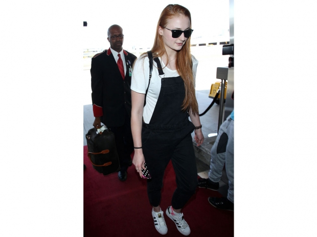 Sophie Turner wearing dungarees at LA's LAX airport