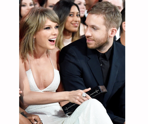 Taylor Swift and Calvin Harris were kissing, holding hands and whispering to ea