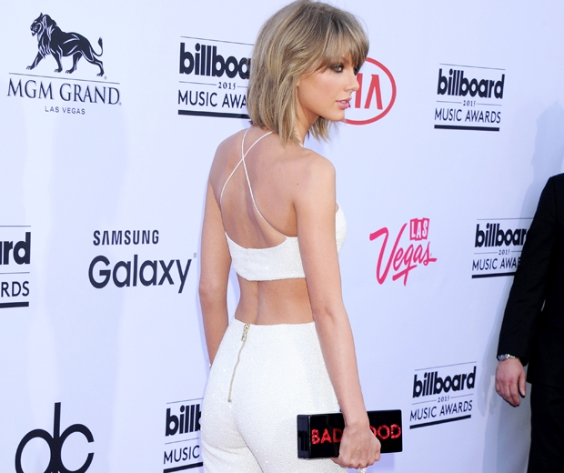 Taylor Swift worked a sizzling white Balmain catsuit to the Billboard Music Awar